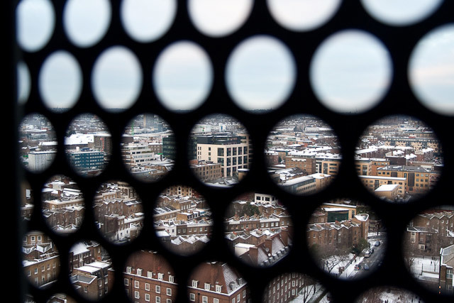 View through the perforated window screen towards Guardian HQ at Kings Place