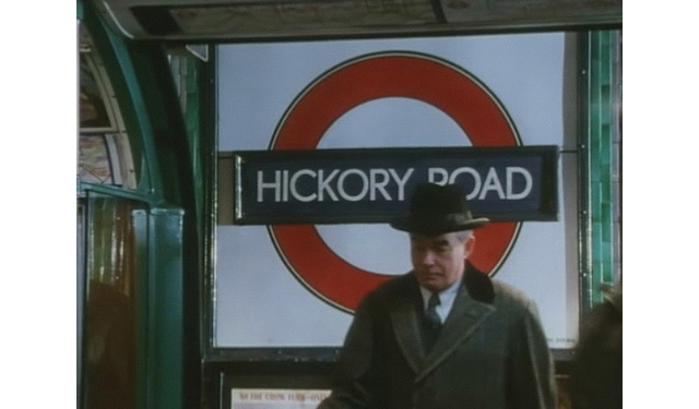 From an episode of Poirot called 'Hickory Dickory Dock'. The scenes were filmed at Morden. Annie Mole has more on this station, including further pictures and discussion.