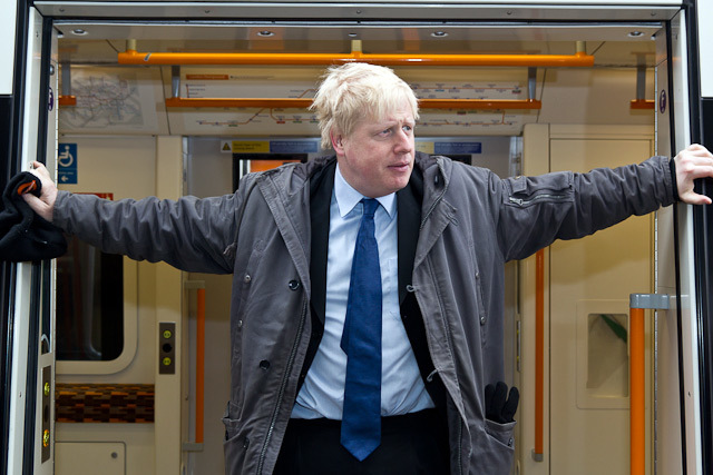 Boris Johnson. Note the Overground-branded beenie hat in his right hand.