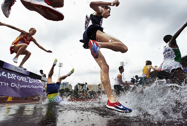1st Prize Sport Stories: Adam Pretty, Australia, Getty Images. Ioran Etchechury of Brazil trips and falls headfirst, during the Boys 2000m Steeplechase, at Bishan Stadium, during the Youth Olympics in Singapore, in August