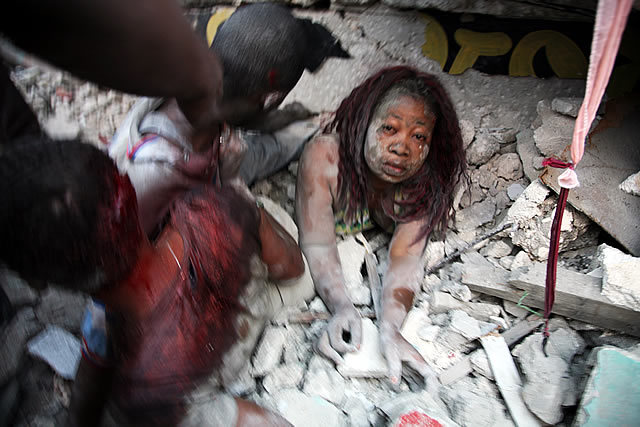2nd Prize Spot News Single: Daniel Morel, Haiti. Rescue of a woman trapped under earthquake rubble, Port-au-Prince, 12 January