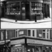 An old apothecary in Soho in 1910 (top). A snack bar sits on the same site today (bottom).