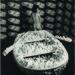 Kusama posing in Aggregation: One Thousand Boats Show 1963. Installation view, Gertrude Stein Gallery, New York. © Yayoi Kusama and © Yayoi Kusama Studios Inc