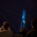 A man takes a photo of the shard