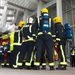 Firefighters in breathing apparatus talk tactics