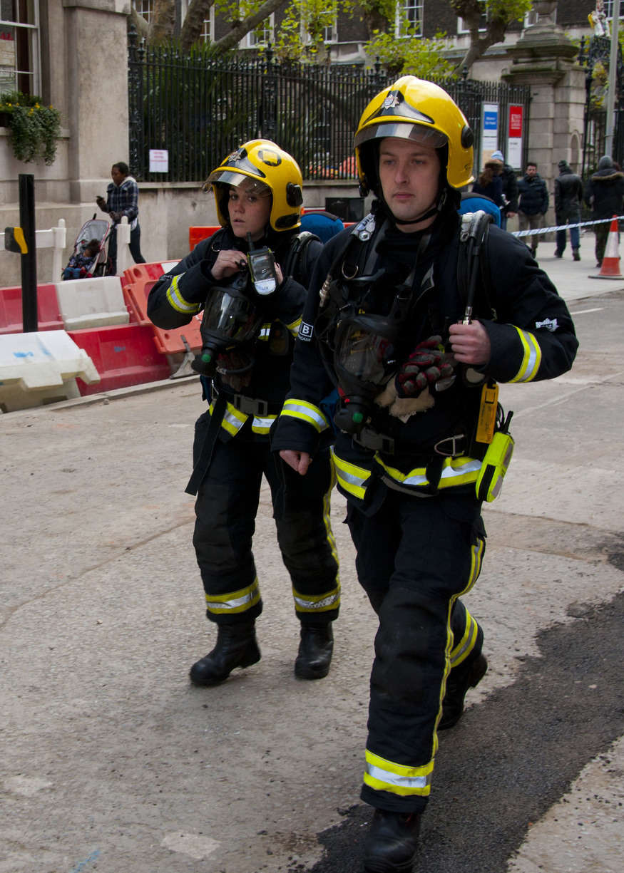 Firefighters in breathing apparatus arrive