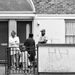 What are you doing? : A family in their front garden watching the Mayor's Festival parade pass by their house.