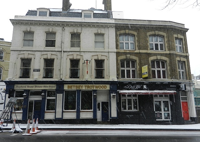 The premises (to the right), directly adjoining the Betsey Trotwood pub, currently house a disused Italian restaurant.