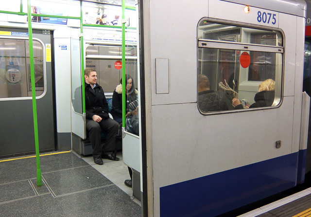 District line train. The white panel covers up the original 'open' button; they were removed from the stock during a mid-2000s refurb. Here's a pic of the train interior with the buttons in place.