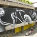 Street artist Phlegm has contributed his trademark sinister art to the walls.