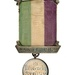 "Suffragette prisoner's silver hunger strike medal with purple, white and green ribbon at the Museum of London. This was presented to Emmeline Pankhurst to commemorate her hunger strike when serving a nine-month sentence in Holloway jail for ""conspiracy to incite persons to commit damage to property"". © Museum of London"