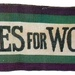 A suffragette sash in their colours: green, purple and white