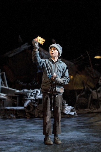 Charlie Bucket gets his golden ticket. Photo by Helen Maybanks