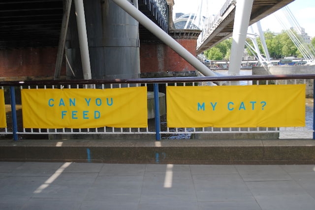 Artist Bob and Roberta Smith has created a series of yellow banners promoting neighbourliness.