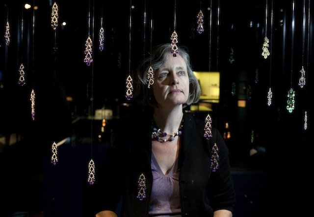 EDITORIAL USE ONLY Jackie Keily, Museum of London curator looks at Amethyst briolette pendants included in the Cheapside Hoard: London's Lost Jewels Exhibition at the Museum of London, which will open to the public on Friday 11 October.  PRESS ASSOCIATION Photo. Issue date: Thursday October 10, 2013.  The extraordinary and priceless cache of nearly 500 late 16th and early 17th century jewels and gemstones - displayed in it's entirety for the first time in over 100 years - was discovered in 1912, buried in a cellar on London's Cheapside.  Photo credit should read: David Parry/PA Wire