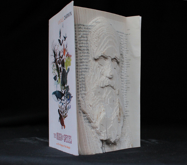 """Andrew Breeson: 'Darwin is remembered for his ideas, and so the best way I could think to represent him was to sculpt him out of the material embodiment of his ideas – The Origin of Species. Scorch marks are visible, and were deliberately left as I liked that they showed the process of production.""""' © UCL, Institute of Making/Robert Eagle"""
