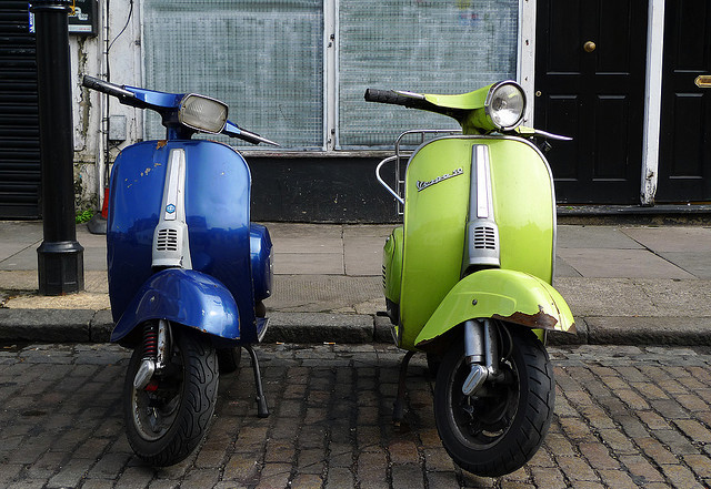 Blue and Green vespas in Stroud Green, by Emily Webber on Flickr.