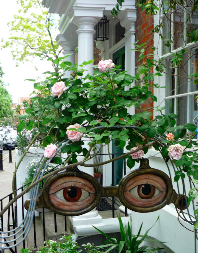 A very green optician sign in Richmond Green, by shadow_in_the_water on Flickr.