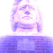 The fabulously coiffured head of Joseph Paxton, creator of the Crystal Palace, presides over the ruins of that edifice in Crystal Palace Park. He's not actually purple. We took this photo years ago on a camera phone and it is, frankly, a bit shit. By playing with the filters a bit, we can at least make it artistically shit.