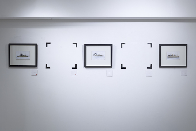 Pablo Delgado uses black tape to indicate the place of the painting, which is not actually there