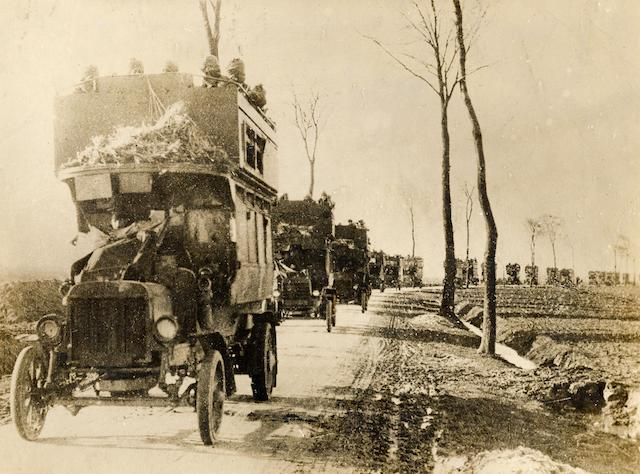 A procession of B-Type LGOC motor buses transporting troops during the First World War. Copyright TfL.