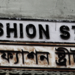 Fashion St near Spitalfields. Many signs in this area are bilingual, in English and Bengali. Image: Stephanie Sadler.