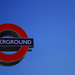 Tube sign against blue sky, by Alison Kinsey on Flickr