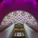 King's Cross station aglow in purple, by V