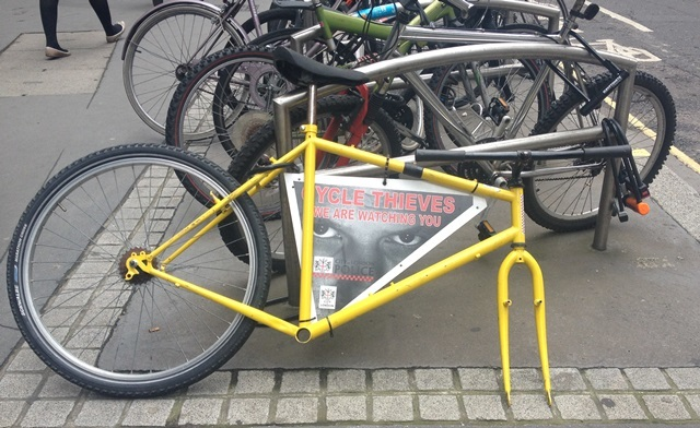 Police bike locked up with wheel missing