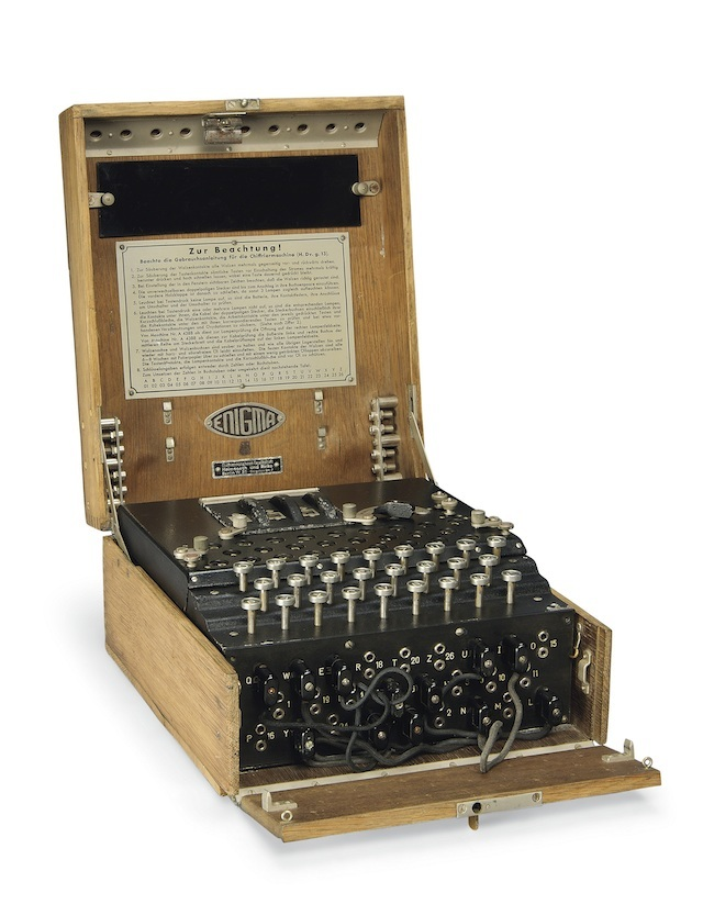 A three-rotor Enigma cipher machine, circa 1939. It has an electric core, three aluminium rotors each stamped WaA69, raised 'QWERTZ' keyboard with crackle black painted metal case, plugboard in the front with six patch leads and green night-time filter, in wooden carrying case. (Estimate: £40,000-£60,000)