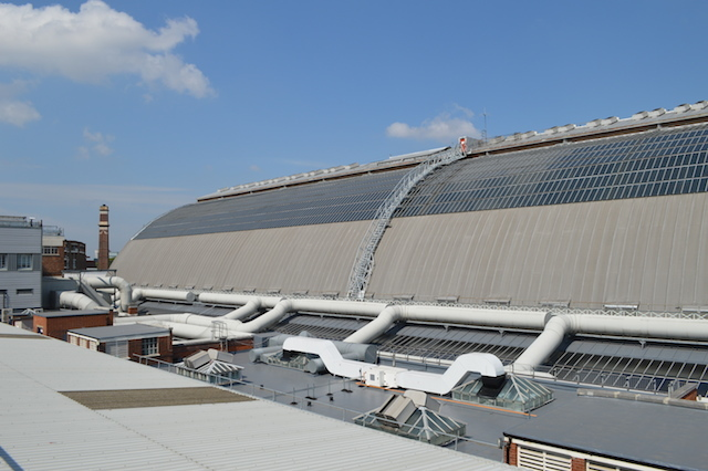 Looking across to the roof of Olympia Grand. The movable gantry that provides access to the roof can be seen in the middle.