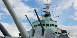 Why Do The Guns Of HMS Belfast Point At A Motorway Service Station?