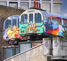 Tube trains covered in graffiti