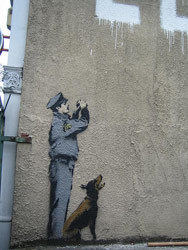 Banksy dog graffito