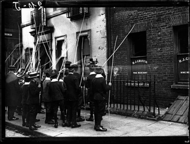School children participate in the annual 'beating the bounds' ceremony near Tower, date unknown.