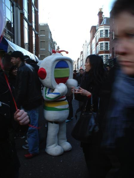 The Hong Kong TV station mascot stays warm in London