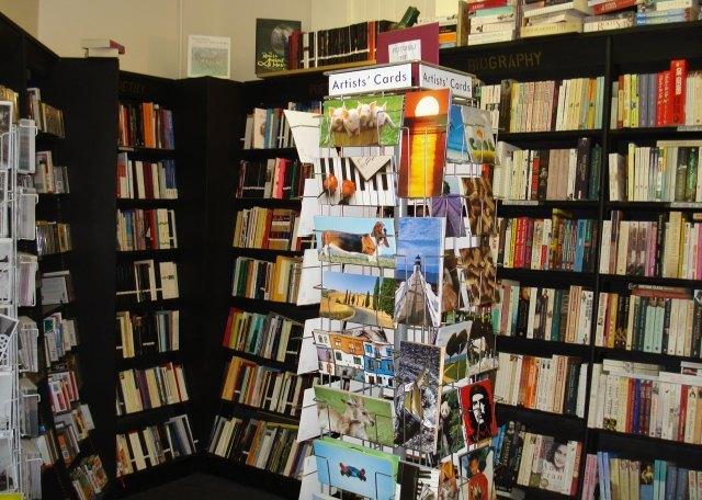 Peruse the artists' card among the bookshelves