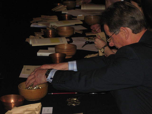 Coins are counted into a wooden bowl, with one coin from every sample placed in the copper bowl for further testing.