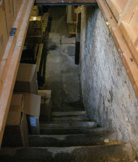 The steep steps down into the eighteenth century basement