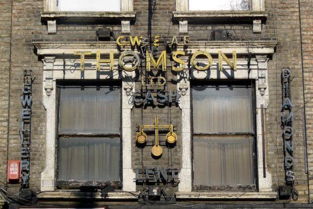 The fantastic New York-esque signage of Thompson Ltd above Navals Jewellers, Kilburn High Road, NW6