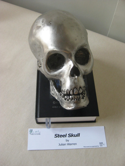 Julian Warren's Steel Skull sits atop a copy of the Origin of Species.