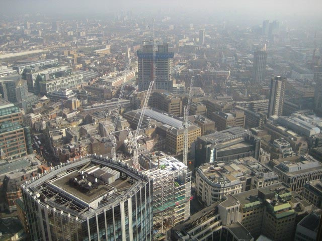 Looking west. The white, steel-framed building down at bottom is the Heron Tower. In a year's time, it'll be taller than Tower 42. Photo by John Wilkes.