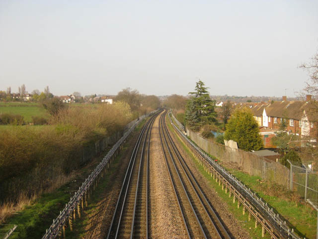 We cross the Central Line tracks north of Buckhurst Hill. The arrival of the Tube in these parts led to the rapid growth of many small hamlets, but the area retains an air of the countryside.