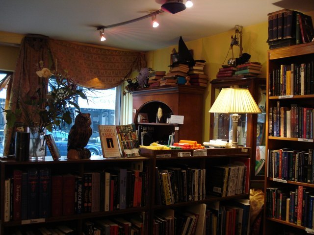 Swagged curtains, piles of books and table lamps. This is how bookshops should be