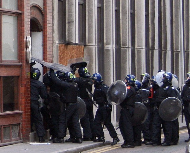 Riot police storm the a building in Earl Street on Thursday / image by Tanya N