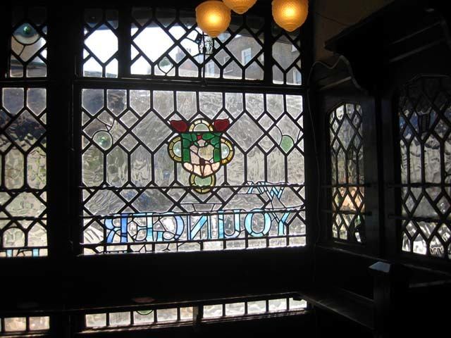 One of the windows at the Tudor Rose. Image by M@.