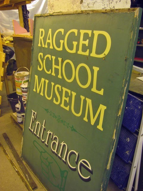 An old sign sits in storage.