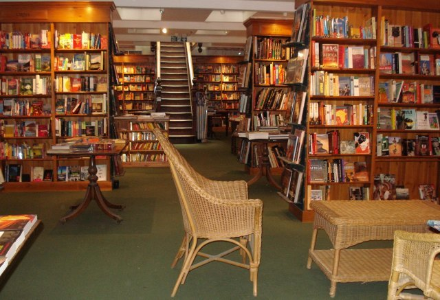Even more travel books and a jaunty colonial-style wicker set in the basement