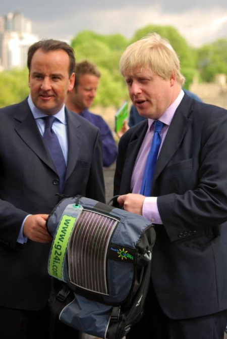 Boris inspects the photovoltaic solar panels built into the cyclists' panniers
