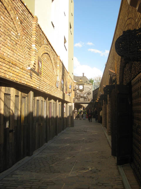 Looking south-east along the new passage. The arches to left and right formerly connected. This cobbled path was knocked through.